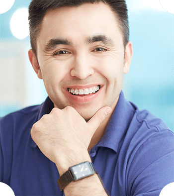 An adult wearing braces, which is available at Chatham Orthodontics