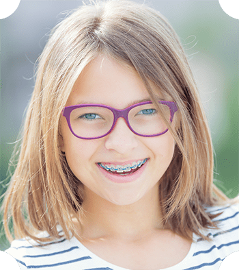 A child wearing braces, which is available at Chatham Orthodontics