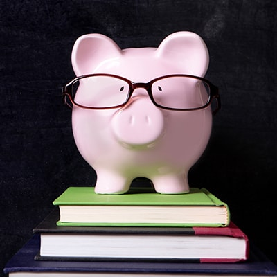Piggy bank wearing glassed to represent the flexible financing offered at Chatham Orthodontics